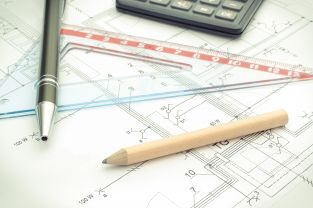 drawing-accesories-and-calculator-on-housing-plan-W6GP7QS-min